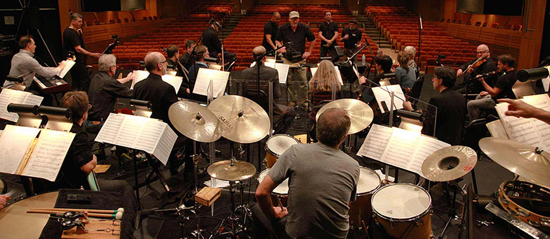 Burlington New Millennium Orchestra with conductor Charles Cozens rehearse at the Burlington Performing Arts Centre