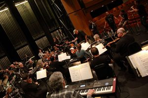 BNMO full symphonic orchestra rehearsing with The Nylons