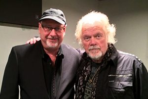 Randy Bachman with an arm on the shoulder of Charles Cozens
